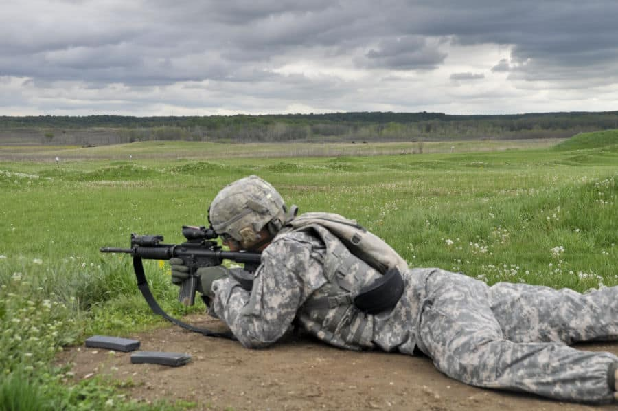 Staff Sgt. Jared Grillo, 1st Battalion, 293rd Infantry Regiment, Bravo Company, Indiana Army National Guard, fires an M4 in weapon qualifications at Atterbury Muscatatuck near Edinburgh, Ind.