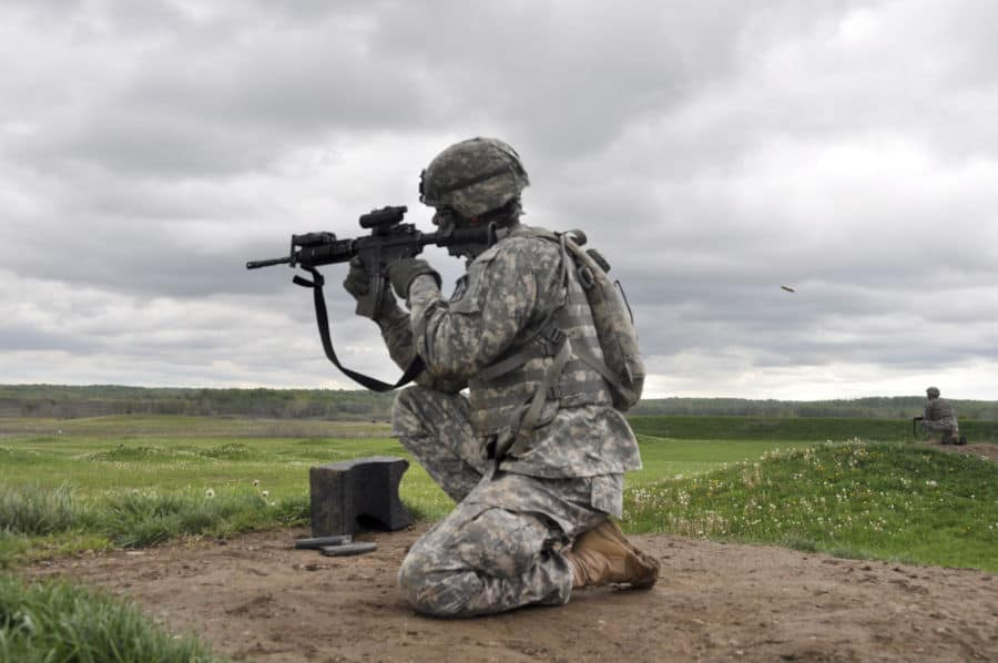 Pfc. Keondre Davis, 1st Battalion, 293rd Infantry Regiment, Bravo Company, Indiana Army National Guard, fires an M4 in weapon qualifications at Atterbury Muscatatuck near Edinburgh, Ind.