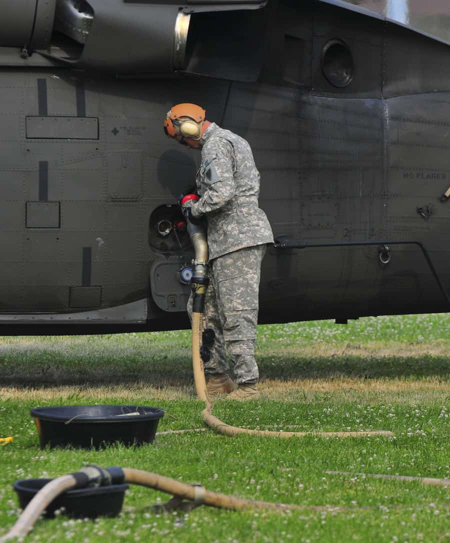 Spc. Joshua Gruenbaum, Company E, 1st Battalion, 137th Aviation Regiment, Ohio National Guard, Gahanna, Ohio, refuels a UH 60 Black Hawk helicopter at Muscatatuck, near Butlerville, Ind.