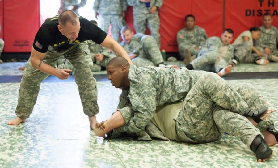 Staff Sgt. James Hanson, chief Combatives school training instructor trains soldiers in close combat.