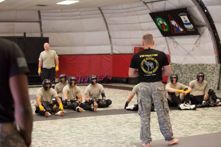 Staff Sgt. James Hanson, chief training instructor in Combatives School passes information to the class.