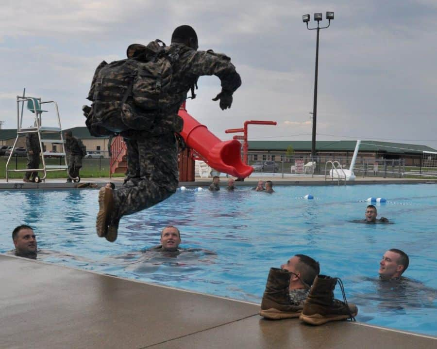 Soldiers with the 1st Squadron, 152nd Cavalry Regiment, Indiana Army National Guard, conduct combat water survival training at Atterbury Muscatatuck near Edinburgh, Ind., as part of annual training. Combat water survival training tests ability to tread water, float and swim while wearing uniform and gear.