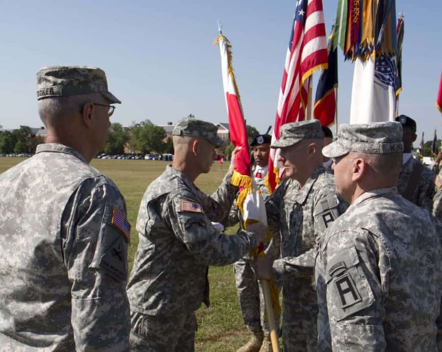 The new First Army Division East Commanding General, Maj. Gen. Jeffrey L. Bailey accepts the colors.
