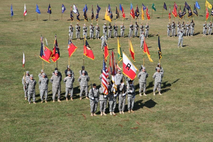Flag bearers across the field.