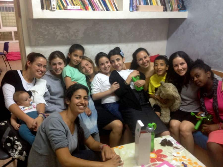 More children of Beit Hayeled with Midreshet Amit volunteers in 2012