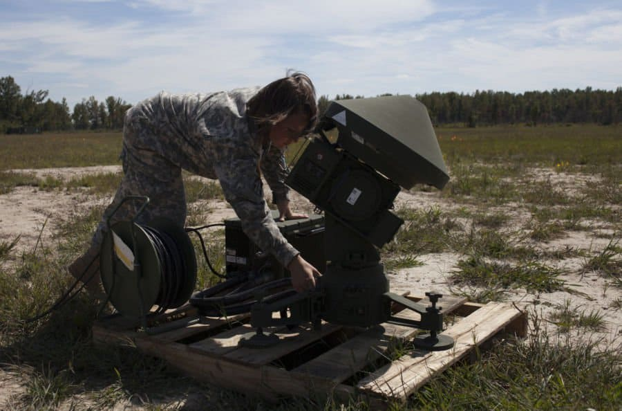 Spc. Katrinna Arnett, of Finley, Ohio, with Company B, 76th Special Troops Battalion, 76th Infantry Brigade, Indiana Army National Guard, sets up the Tactical Automatic Landing System for the RQ 7B Shadow Unmanned Aerial System at Jefferson Proving Ground, near Madison, Ind.