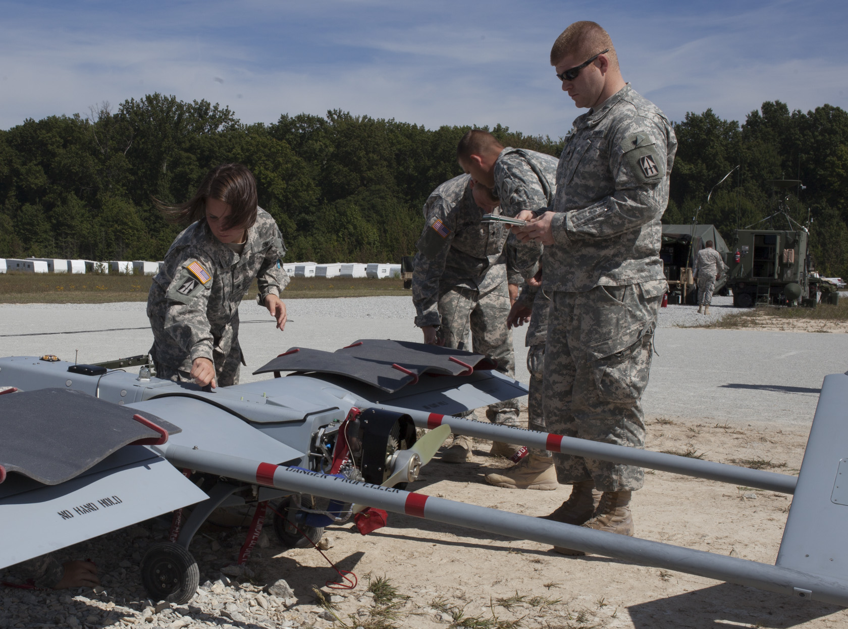 Soldiers with Company B, 76th Special Troops Battalion, Indiana Army National Guard, and the Army 3rd Brigade, 1ID conduct preflight checks on an RQ 7B Shadow Unmanned Aerial System prior to launching at Jefferson Proving Ground, near Madison, Ind.