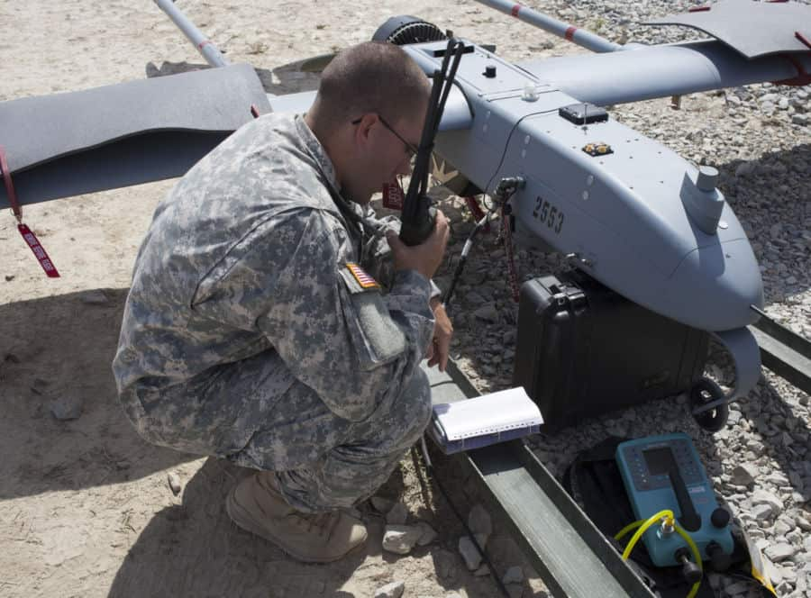 Spc. Charles Harvey, of Fort Knox, Ky., with the Army 3rd Brigade, 1ID, performs preflight checks in preparation to launch an RQ 7B Shadow Unmanned Aerial System at Jefferson Proving Ground, near Madison, Ind.