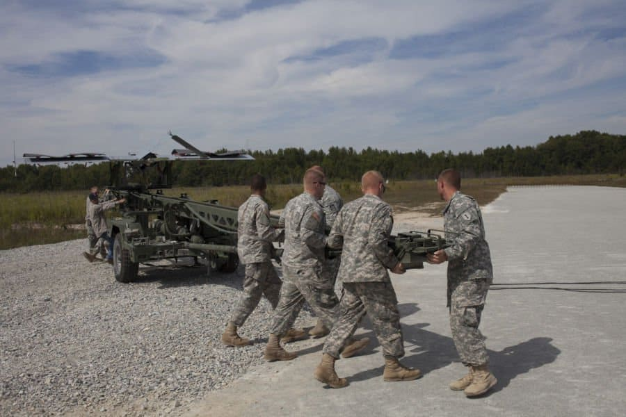 Soldiers with Company B, 76th Special Troops Battalion, Indiana Army National Guard, and the Army 3rd Brigade, 1ID re positions the launch system for an RQ 7B Shadow Unmanned Aerial System prior to launching at Jefferson Proving Ground, near Madison, Ind.