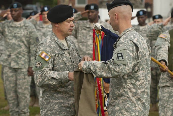 174th Infantry Brigade soldiers prepare to sheath their flag.