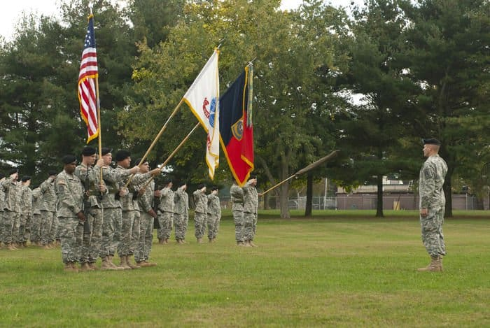 Soldiers carry the Unit colors and the U.S. flag as they begin their yearlong mobilization at Joint Base McGuire Dix Lakehurst, N.J.