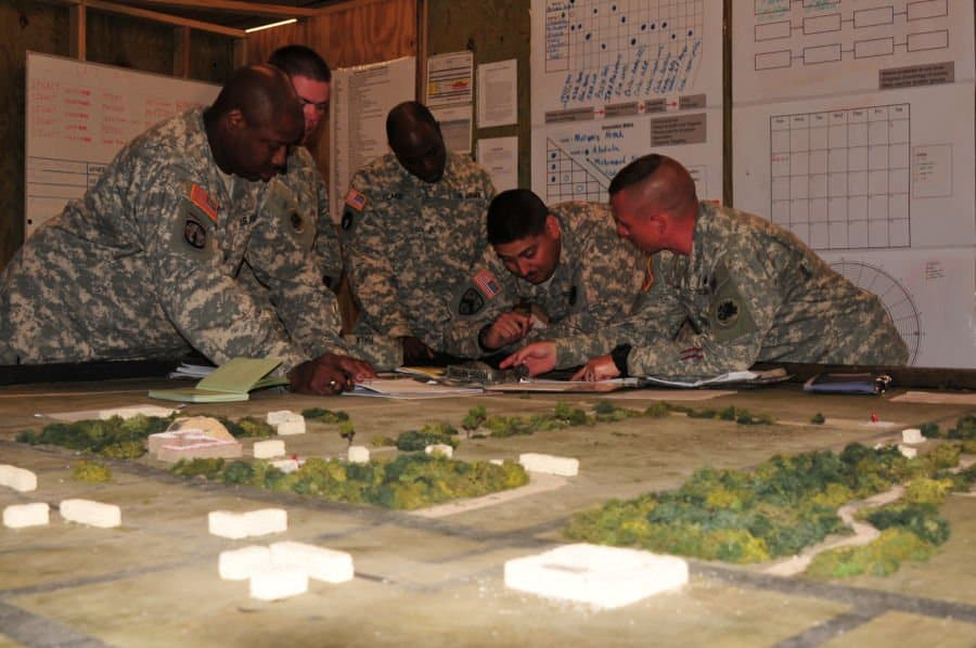 Company Intelligence Support Team members with the 1151st Engineer Company use COIST products and current intel picture overlays as part of Camp Shelby Joint Forces Training Center's new intelligence training tool.