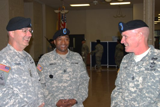 Lt. Gen. Michael Tucker, First Army commander, shares a lighter moment with Command Sgt. Maj. Jesse Andrews, and Command Sgt. Maj. Sam Young, before the change of responsibility ceremony at Rock Island Arsenal Heritage Hall.