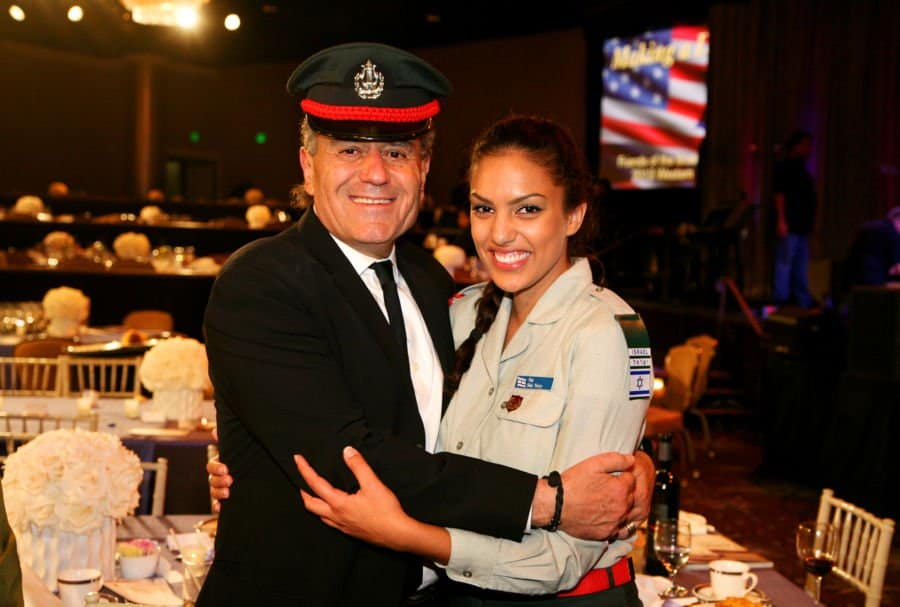Haim Saban and Shay Terry a member of the IDF Choir Photo by Noam Chen