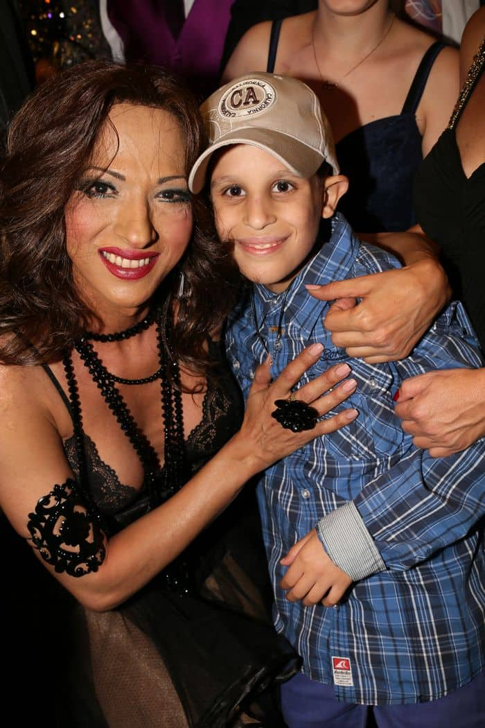 Singer Dana International with one of the visiting children Photo by Orly Halevy