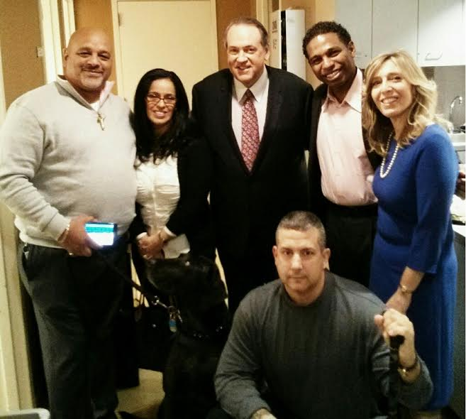 From R Judy Isaacson Schaffer 2nd R Mike Huckabee and a grup of veterans Photo Judy I. Schaffer
