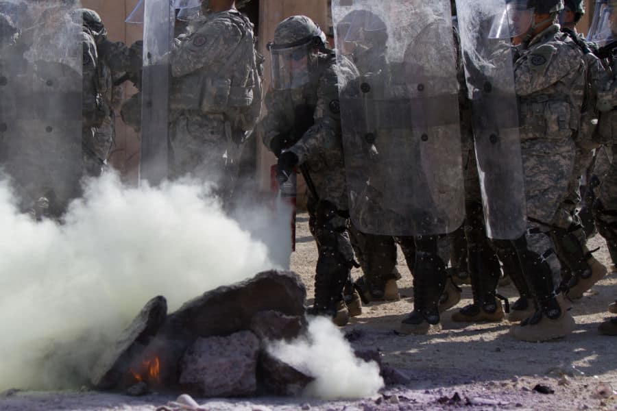 43 Cavalry Regiment soldiers learn riot control and cope with smoky fires.