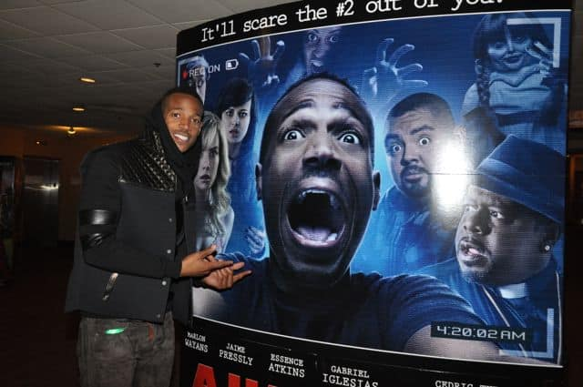 Marlon Wayans poses with the Movie Poster