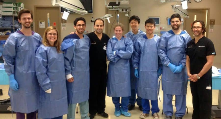 Dr. Talei center with his staff