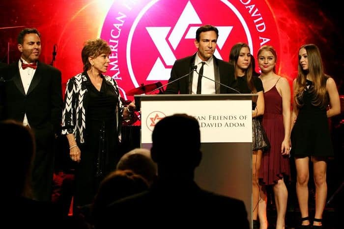 Recipient of Humanitarian of the Year Award, Dr. Bill Dorfman, surrounded by family