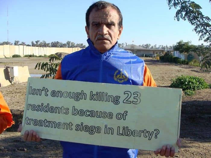 Camp Liberty resident protesting the deaths of 23 residents due to the Iraqi medical siege.