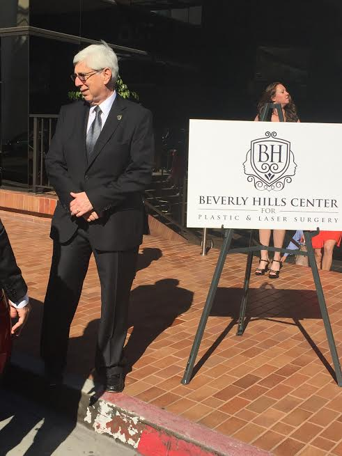 Beverly Hills Mayor Dr. Julian A. Gold MD next to Dr. Taleis Beverly Hills Center for Plasric Laser Surgery sign