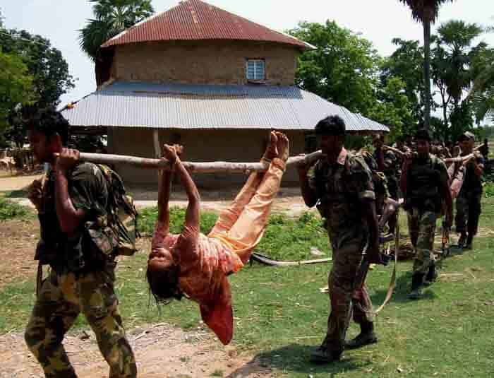 indian security carry dead female maoist 2010