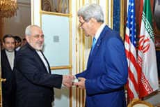 Iranian FM Zarif shakes hand with John Kerry during the Iranian nuclear talks. There is no formal diplomatic relationship between Iran and the USA. State Department photo.