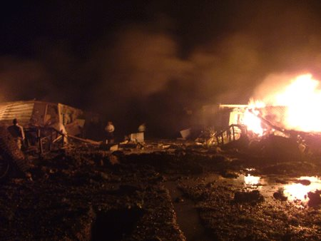 Fires and devastation in Camp Liberty after rocket attack.