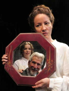 Alyssa Simon as the former wife. In mirror: Laurence Cantor as The Minister, Mary Baynard as his housekeeper.