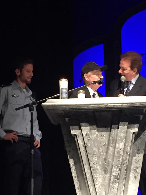 Rabbi David Baron of Temple of the Arts speaks to Mitch on stage.