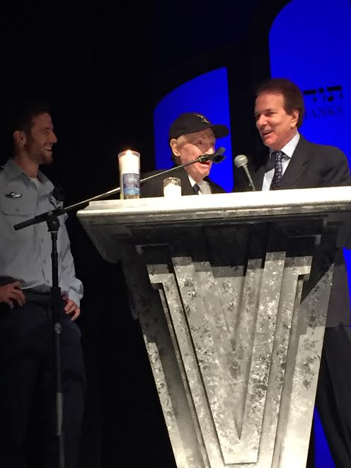 Mitch Flint speak while Rabbi David Baron and Israeli Air Force pilot listen.