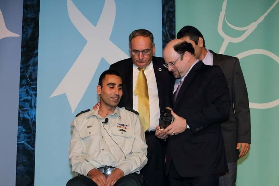 L Lieutenant Colonel Shai Siman Tov honored by Actor Jason Alexander behind him Professor Zeev Rotstein CEO Sheba Photo Oroly Halevy