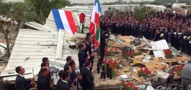 Survivors of the Camp Liberty terrorist attack chant La Marseillaise.