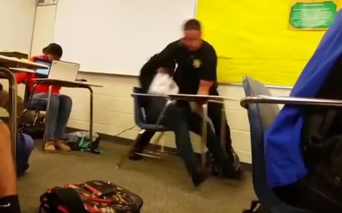 officer drags girl out of her seat