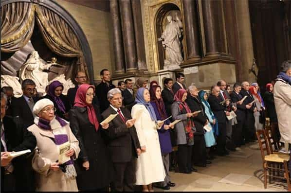 Mrs. Maryam Rajavi, the President=elect of the National Council of Resistance of Iran, attended Christmas Eve service on Thursday in St Germain Abbey, Paris.