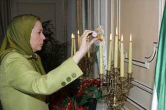 Mrs. Maryam Rajavi lights a candle at the Christmas Eve service in St Germain Abbey, Paris.