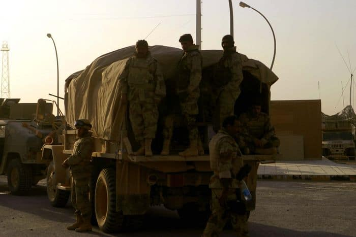 Iraqi soldiers wait for orders in Operation Steel Curtain.
