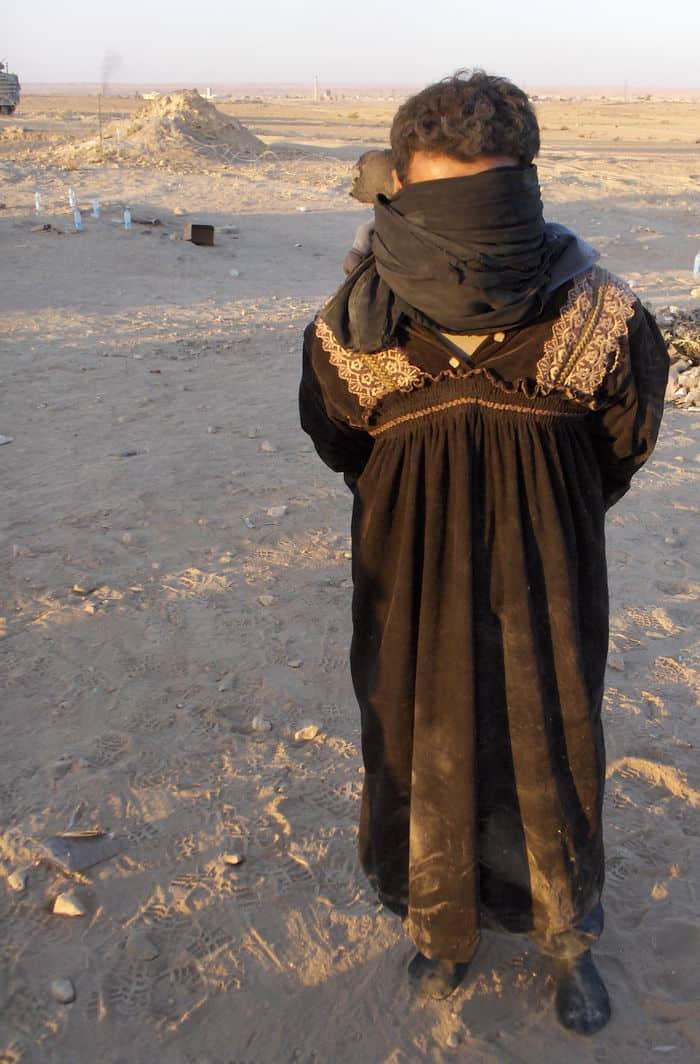 suspected al-Qaeda in Iraq terrorist captured in an Ubaydi hospital dressed in women's clothing.