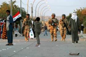 Iraqi Soldiers patrol Husaybah, Iraq in Operation Steel Curtain