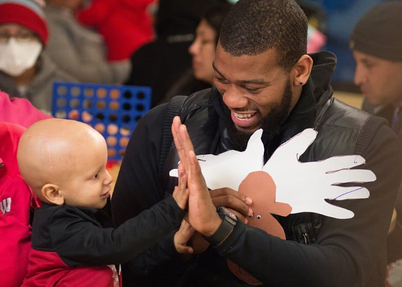 St. Jude ambassador Greg Monroe of the Milwaukee Bucks and Colton.