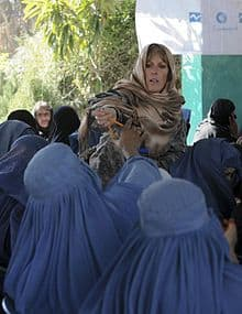 U.S. Army officer Lt Col Pam Moody with a group of Afghan women on International Women's Day 2011.