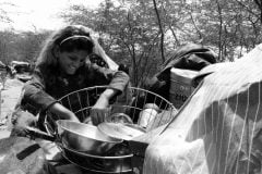 Pakistani Hindu Refugee Girl Selects A Cooking Pot. Photo by Shib Shankar Chatterjee.