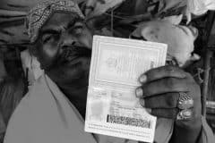 Pakistani Hindu Refugee Man Shows His Pakistani Passport. Photo by Shib Shankar Chatterjee.