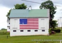 flag painted on large barn