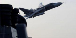 russian fighter overflies US navy ship.