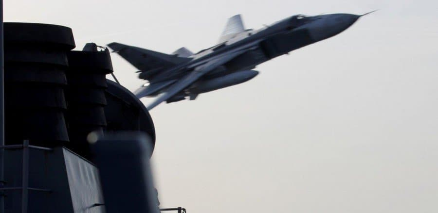 russian fighter jets overfly US navy ship.