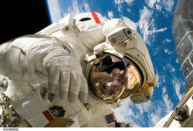 A NASA astronaut in space. new planets.