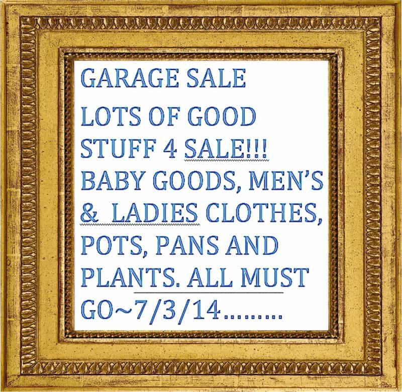 framed garage sale sign.