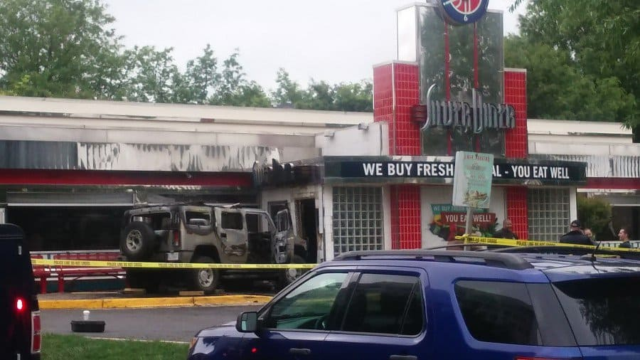 hummer and police tape after ramming diner